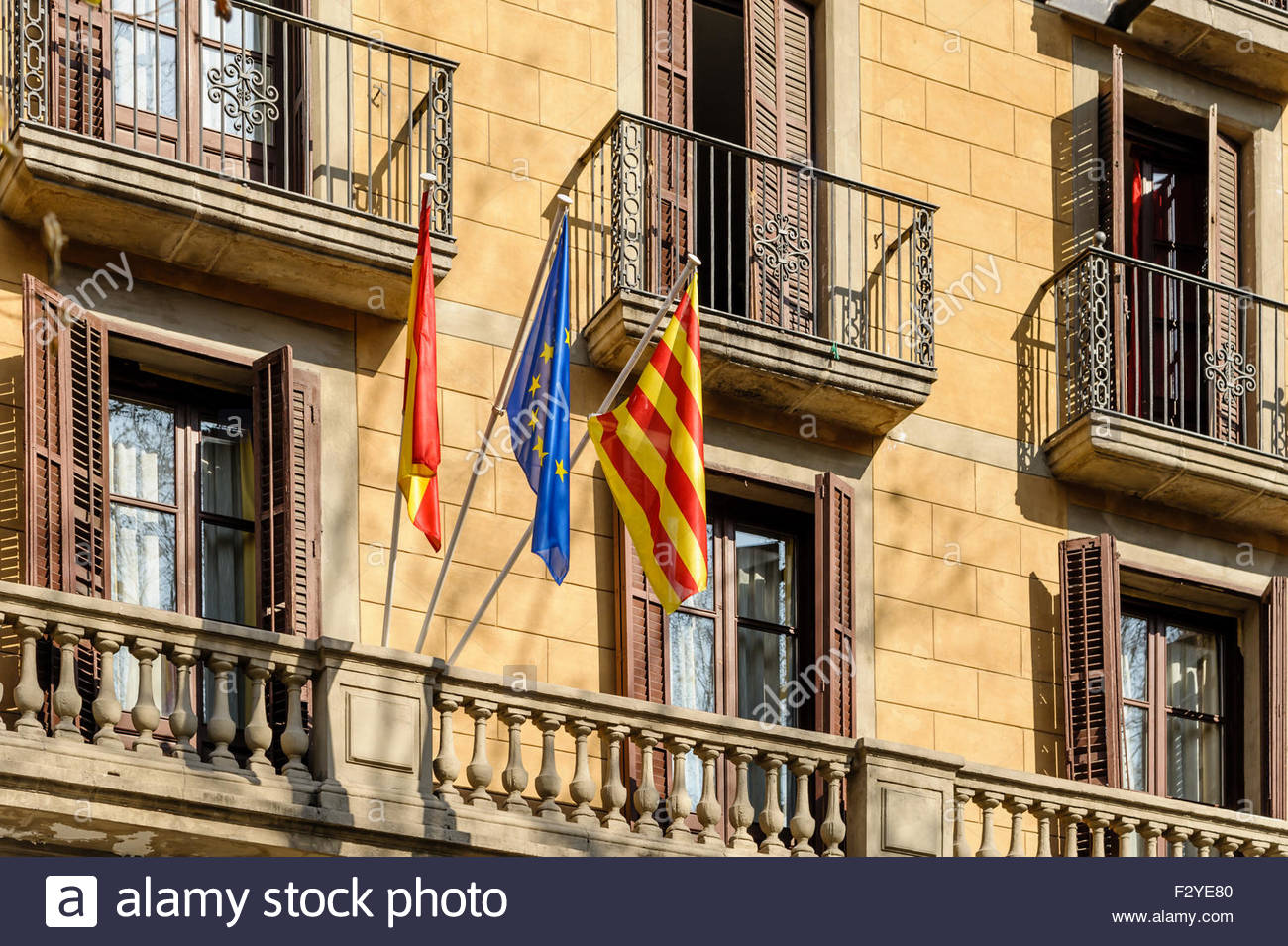 Flags of European Union, Spain and Catalonia outside a building in Barcelona. Stock Photo