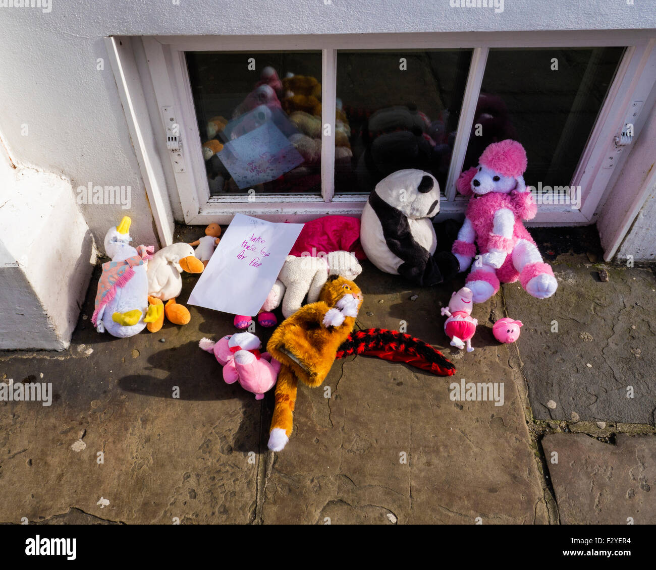Free toys, soft toy give-away, help yourself on pavement in Greenwich, London - Stock Image