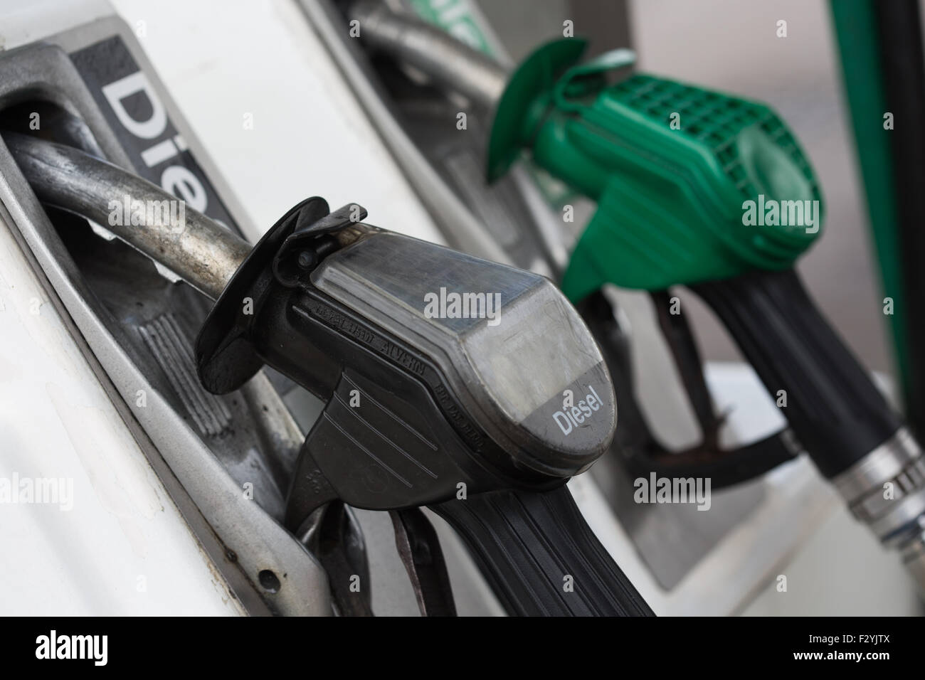 close up shot of fuel nozzle at filling station - Stock Image