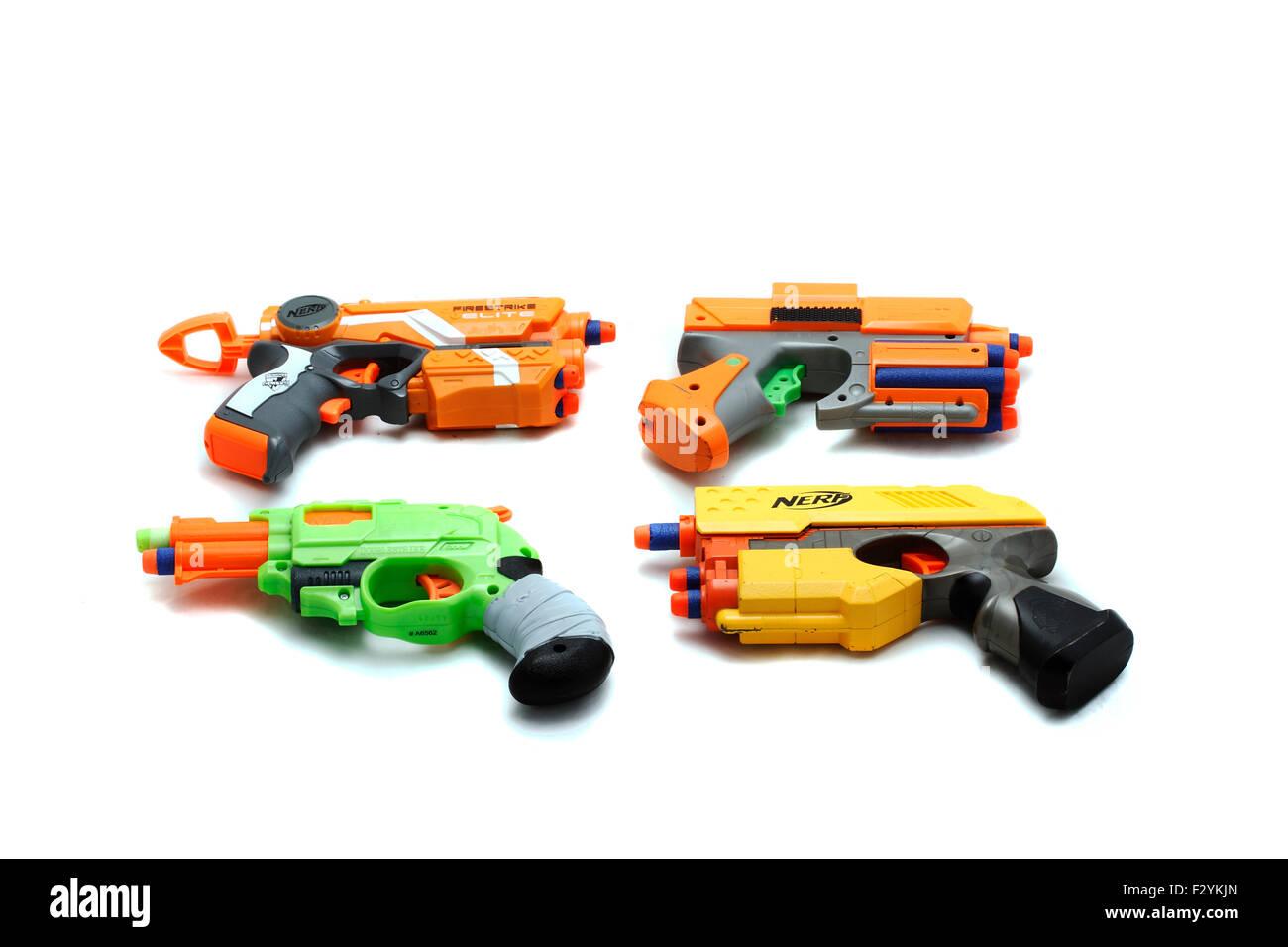 Four Nerf Guns - Firestrike Elite XD, Dark Tag StrikeFire, Nerf Zombie Strike Double strike, Nerf Scout A Nerf Blaster - Stock Image