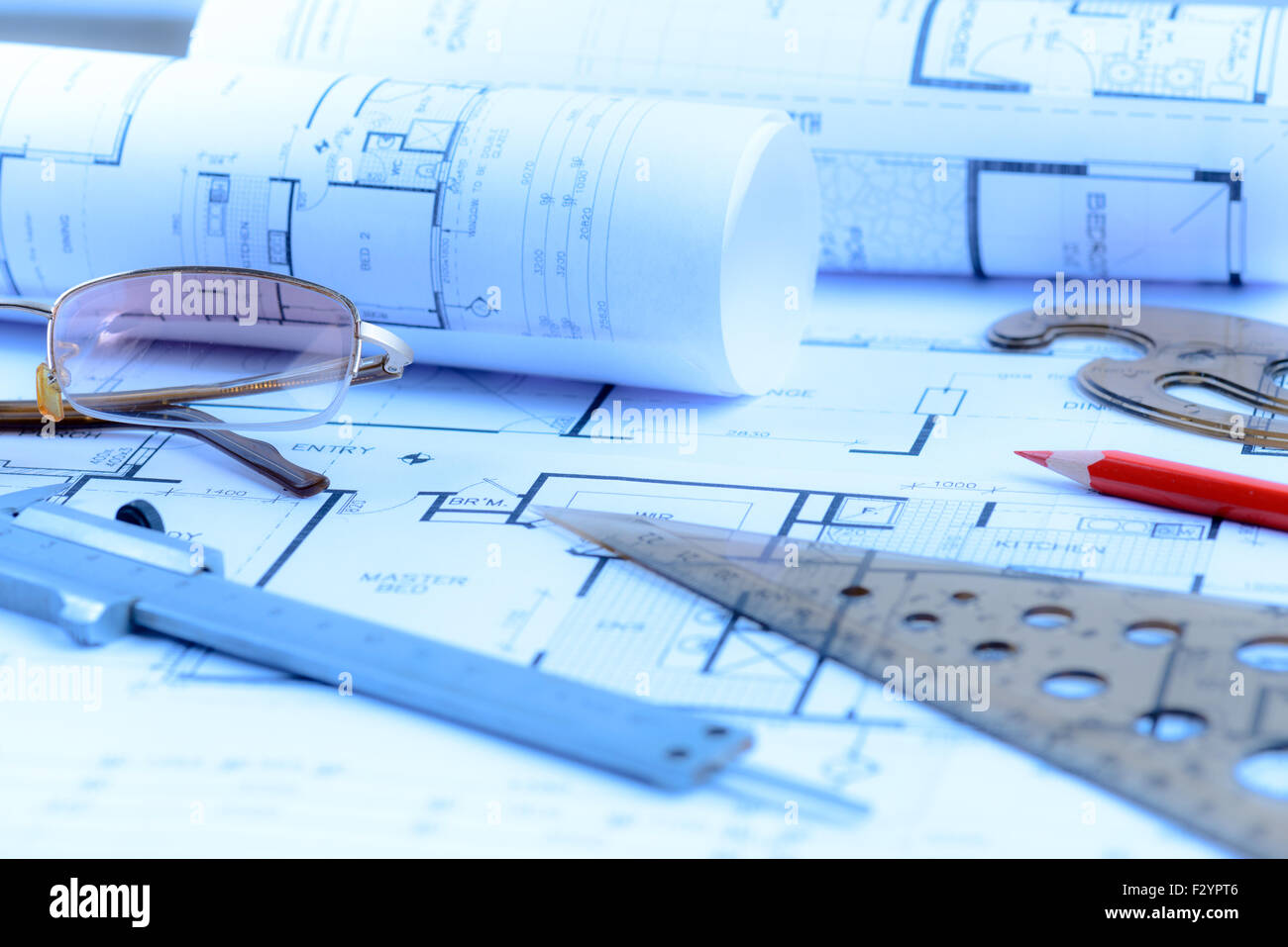Architectural blueprints rolls and engineering items. Toned in blue - Stock Image