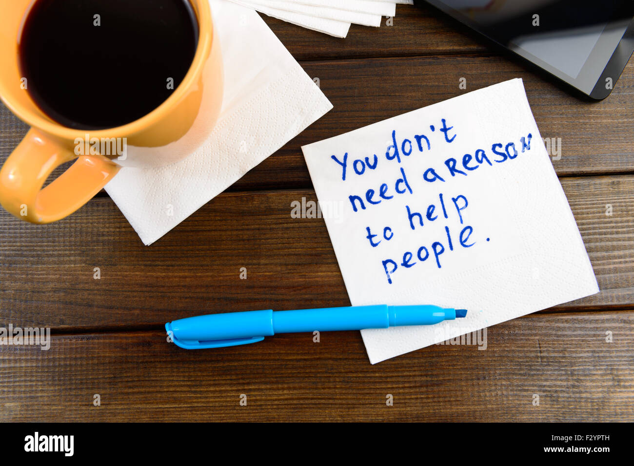 napkin sketch 'Your don't need reason to help people' on cafe napkin - Stock Image