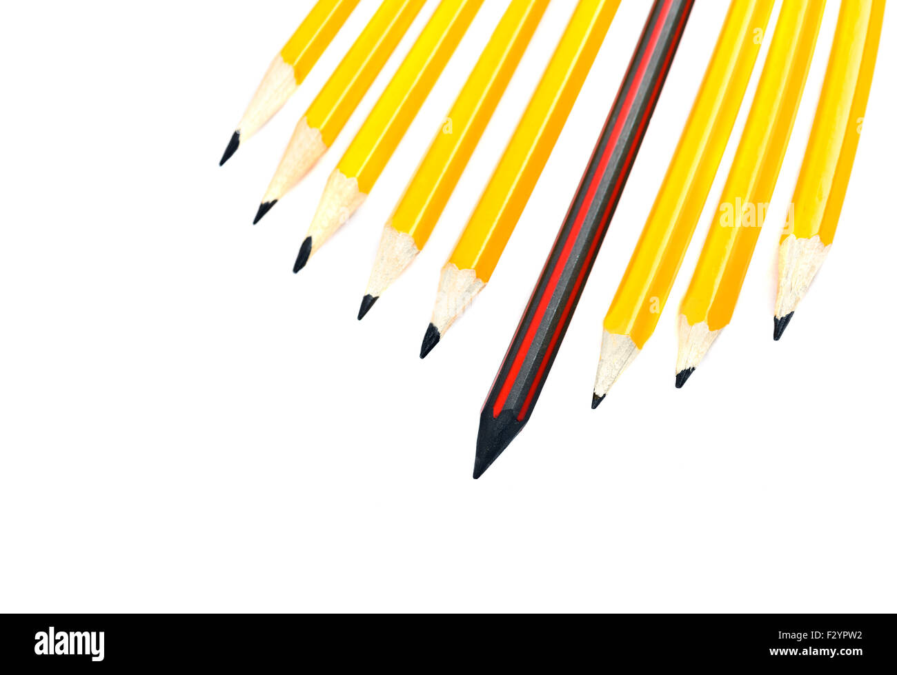 pencil standing out from a bunch of crowd pencils, leadership concept - Stock Image