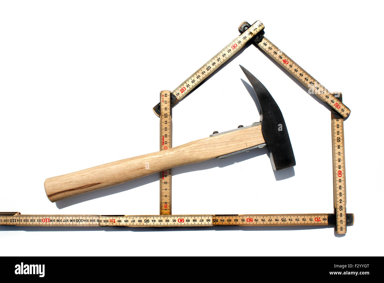 Symbol for carpentry, hammer and meter - Stock Image