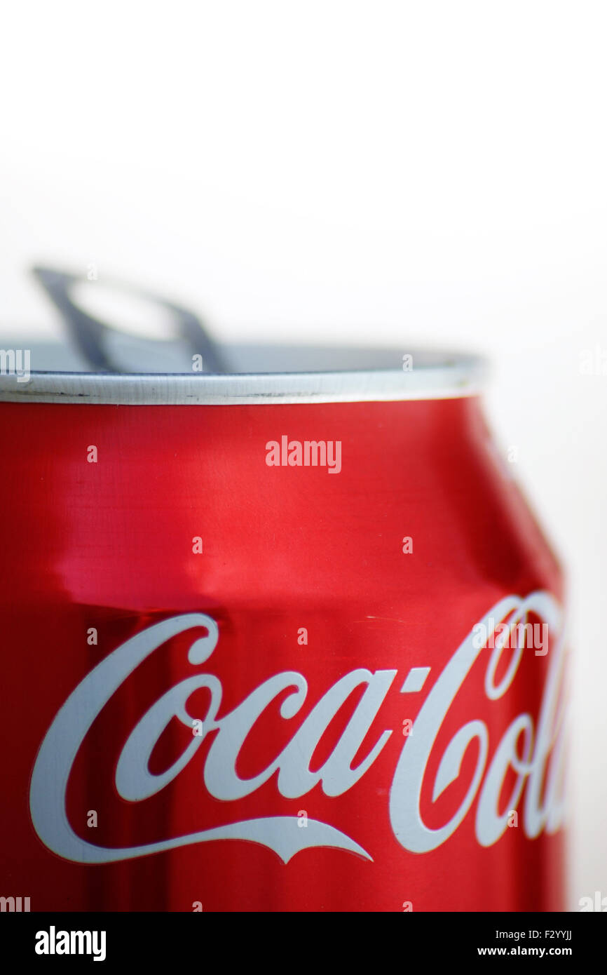 Dry, open, coca-cola can in a golden light setting - Stock Image