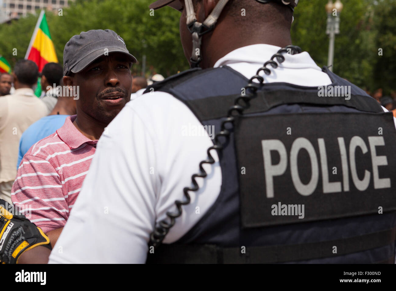 Policeman speaking with civilian protester - USA - Stock Image