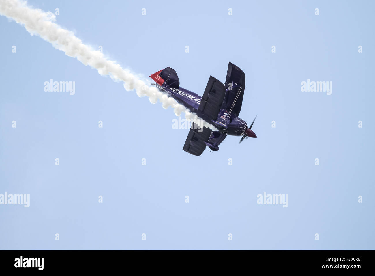 Ali Ismet Ozturk piloting his special biplane called Purple Violet at TATCA Airfest 2015 - Stock Image