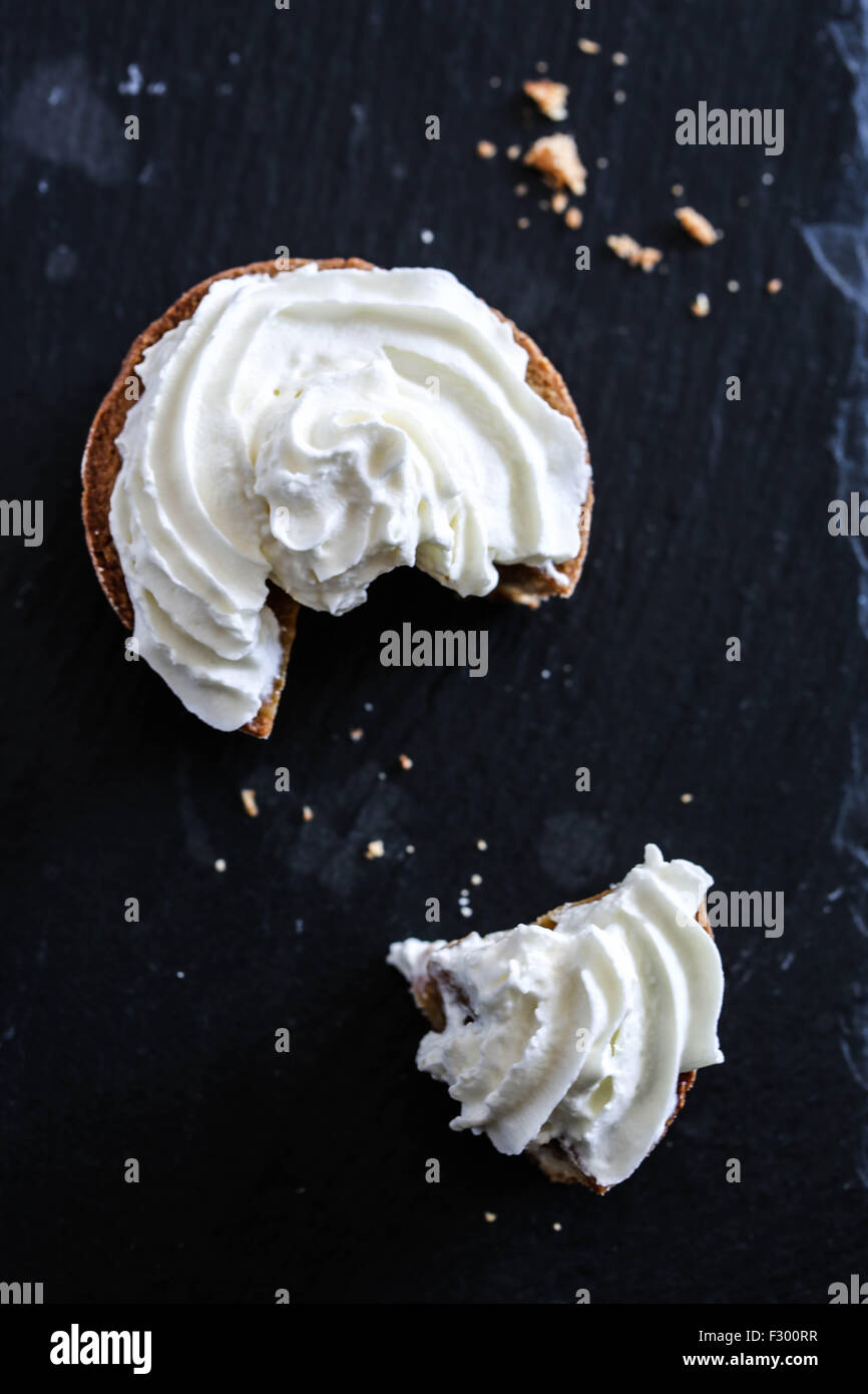 Pumpkin mini pie whipped cream topping - Stock Image