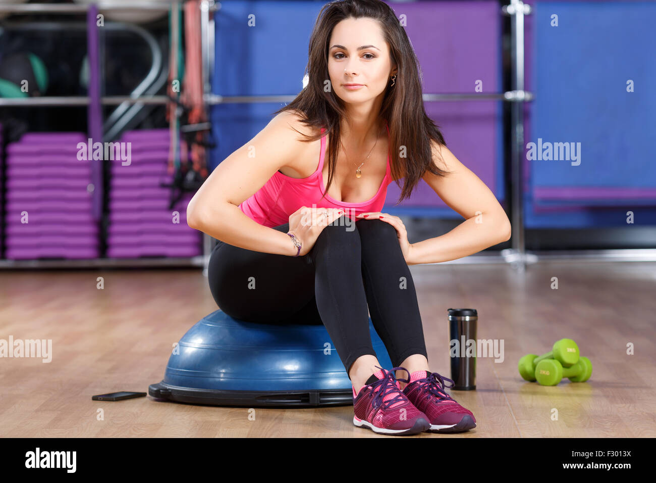 pretty fitness woman wearing in shirt sneakers and black leggings