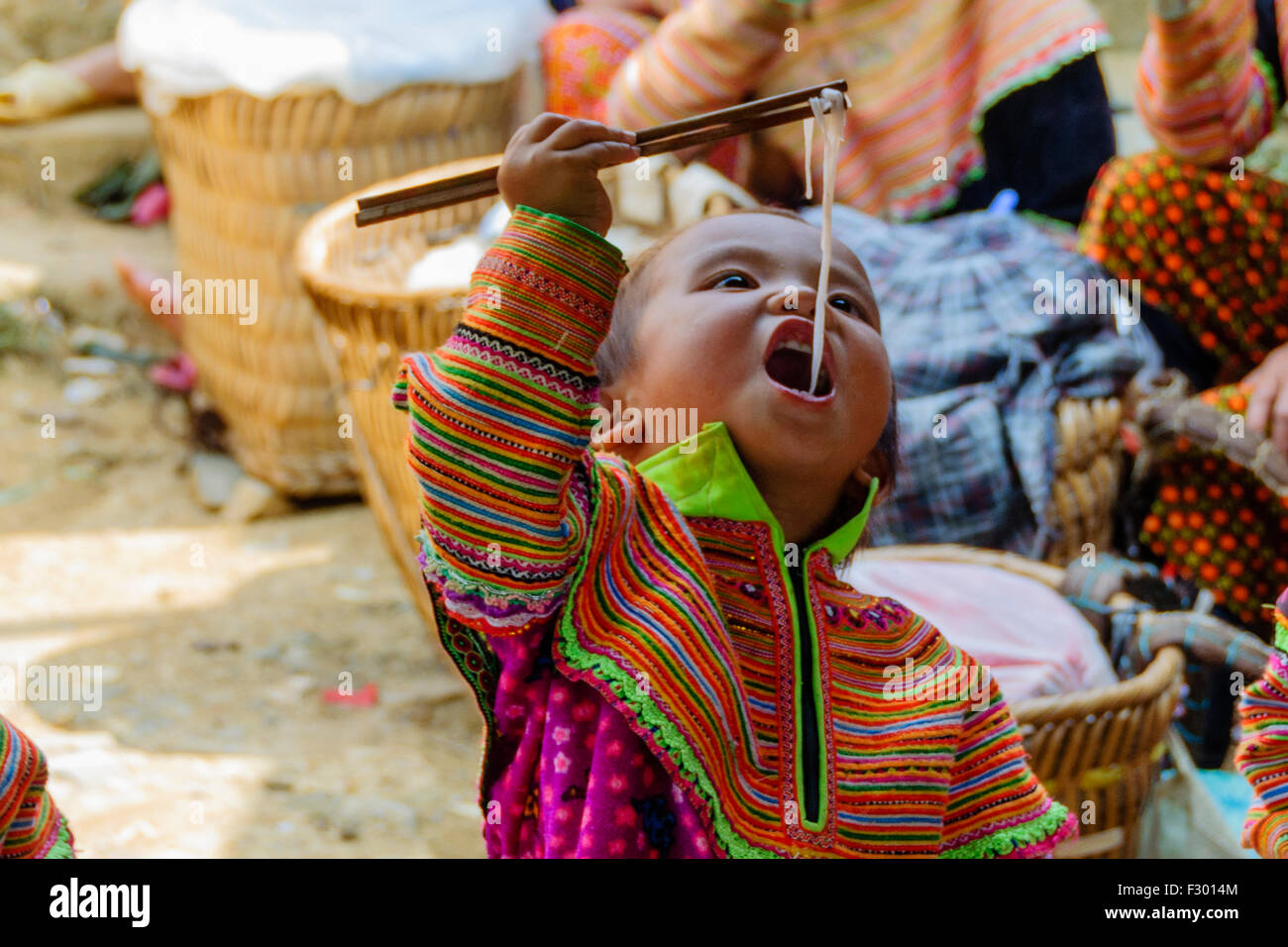 Kid having lunch in Sapa, Vietnam - Stock Image