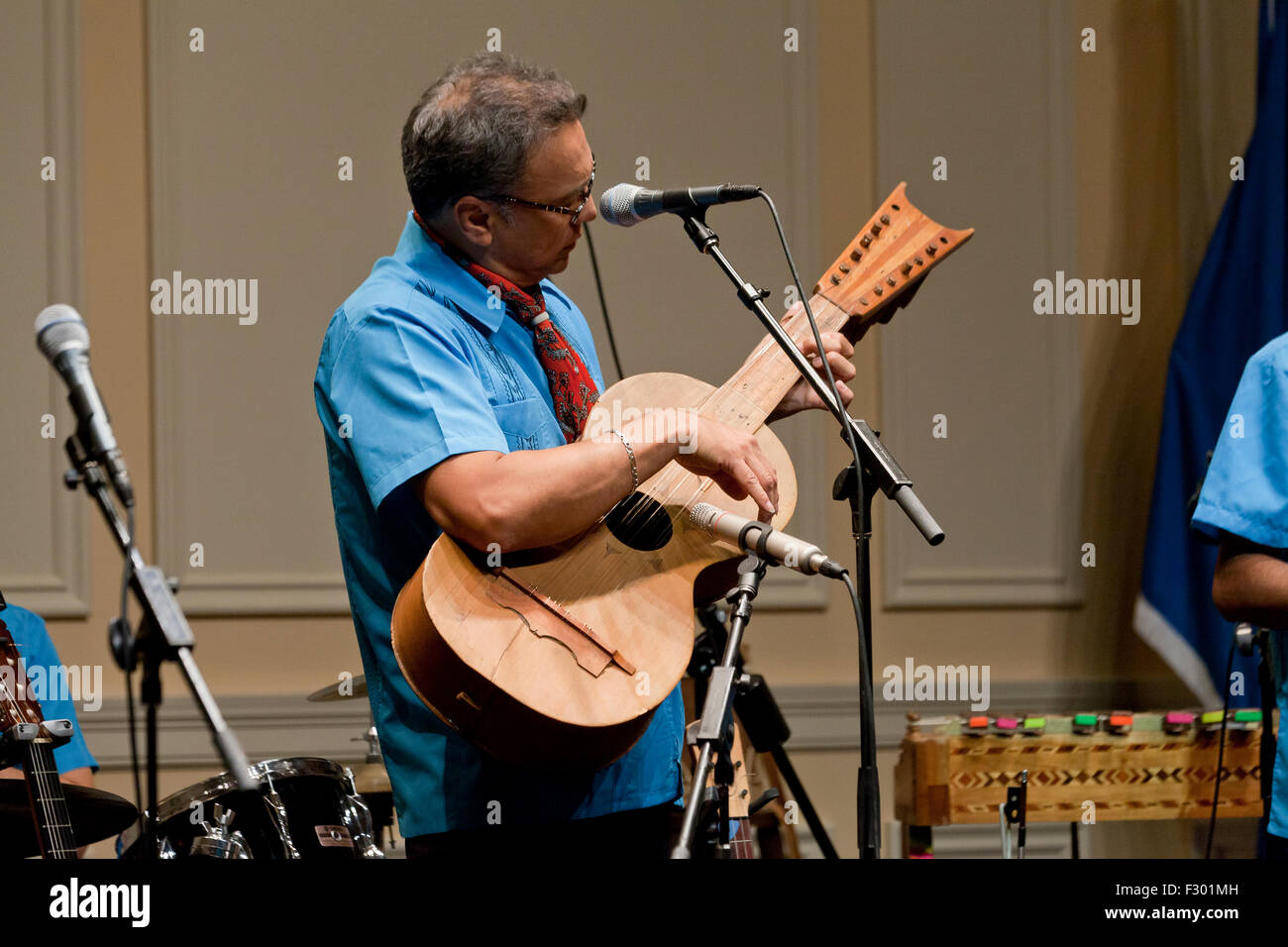 Man playing 12 string Mexican guitar on stage - USA - Stock Image