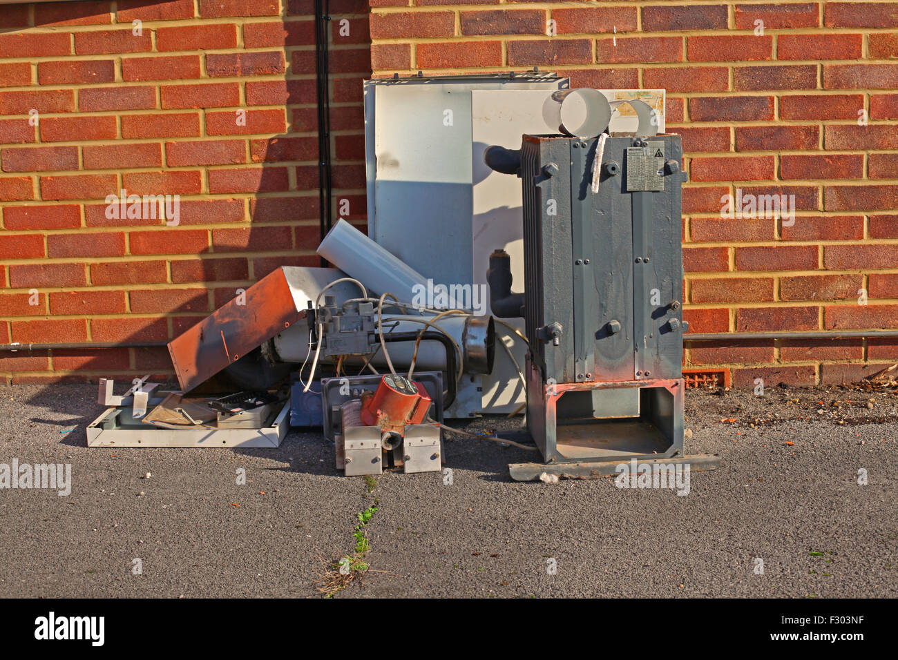 scrap material from a domestic Boiler change including Boiler casing along with a Pump and various parts of Flue - Stock Image