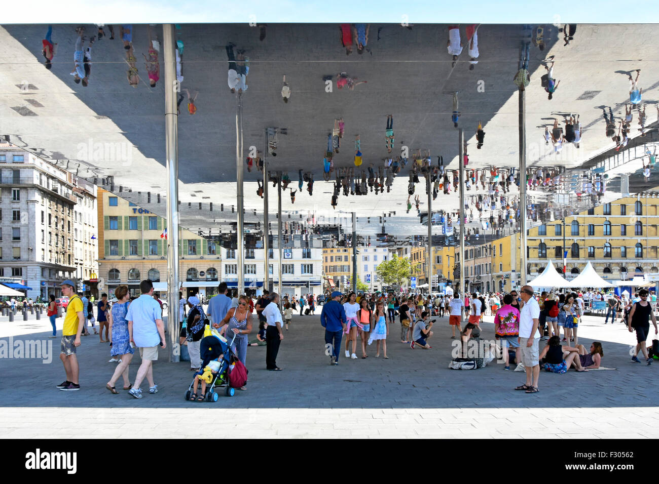 Marseille France Vieux Port Ombriere mirror people image reflections under Norman Fosters canopy in Old Port of - Stock Image