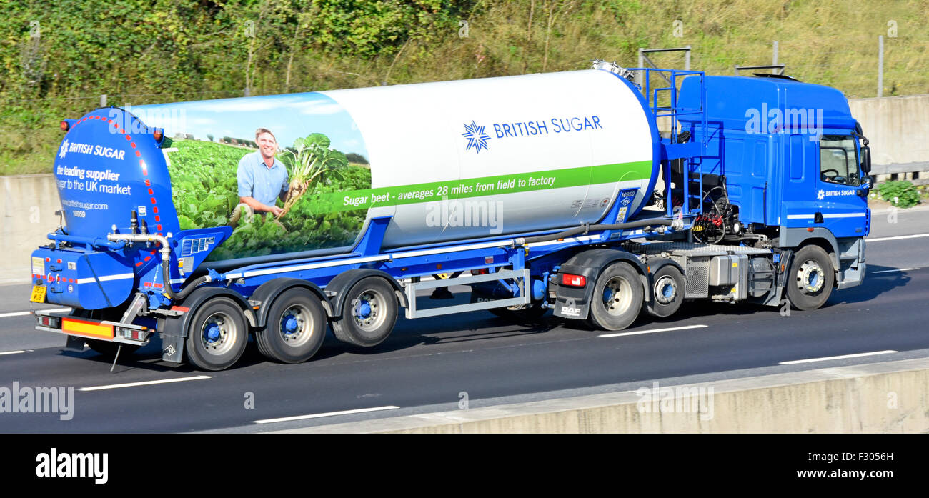 Tanker truck advertising British Sugar beet industry on articulated tanker trailer & hgv lorry driving along - Stock Image