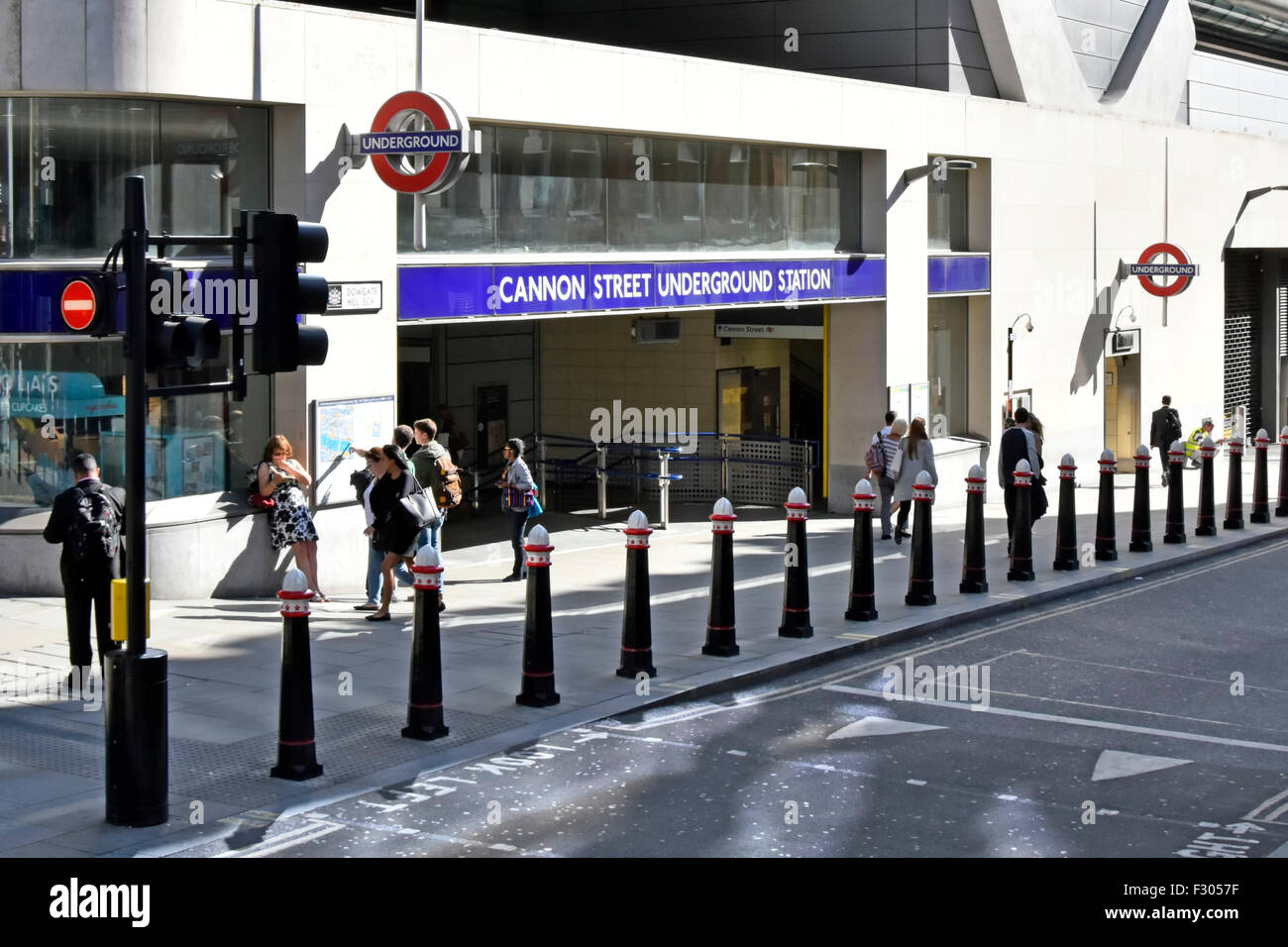 Cannon Street underground train station entrance with bollards protecting pavement & pedestrians City of London - Stock Image