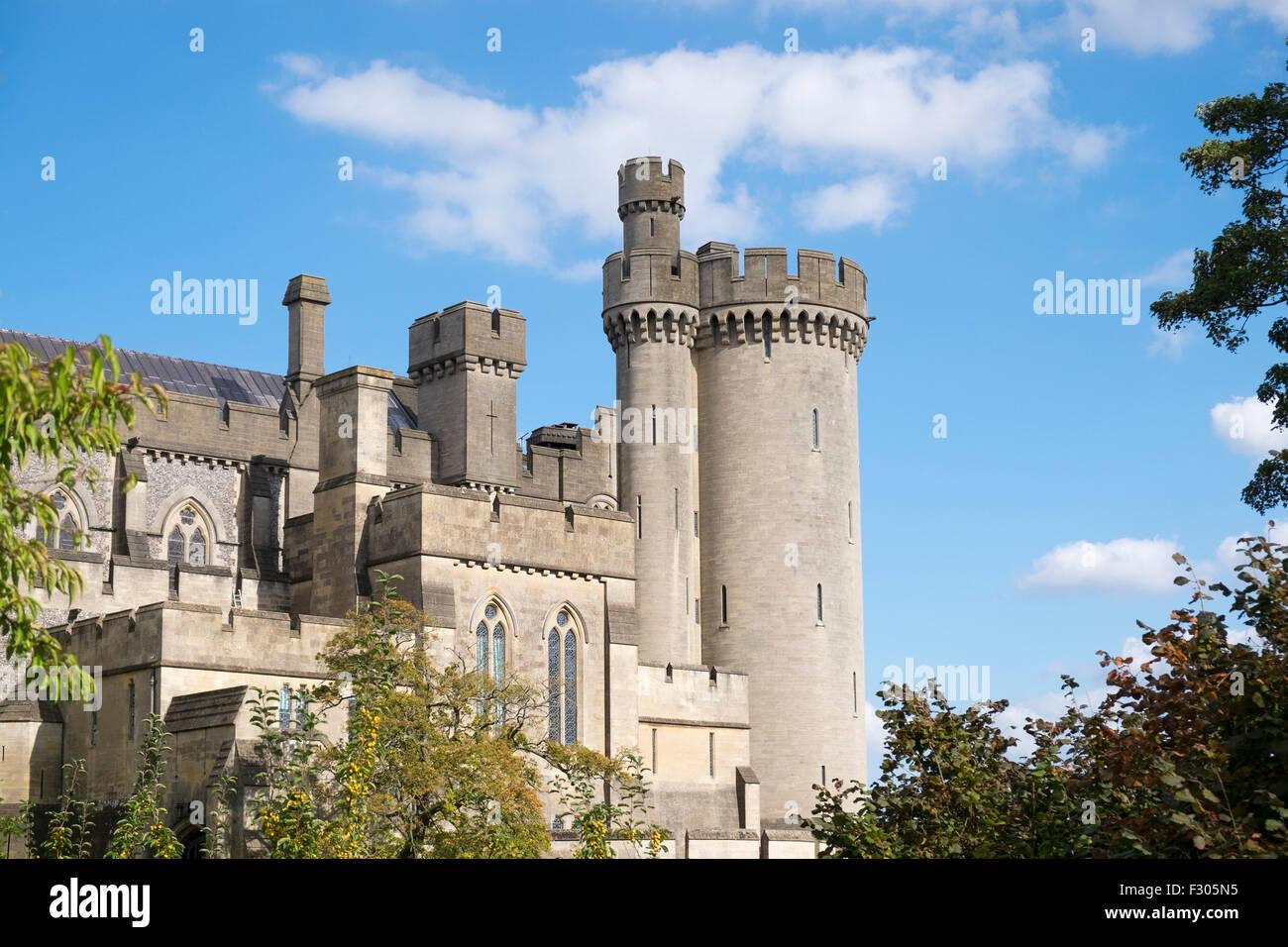 Turrets on Arundel castle framed between trees - Stock Image