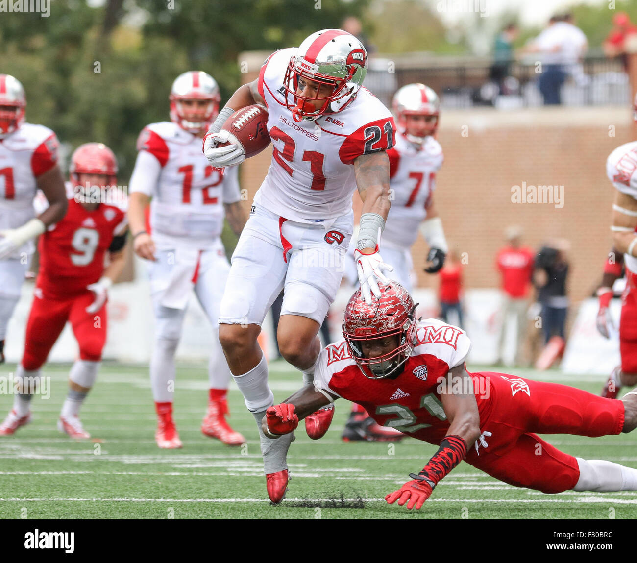 Bowling Green, KY, USA. 26th Sep, 2015. WKU's Jared Dangerfield #21 avoids the diving tackle attempt by Miami's - Stock Image