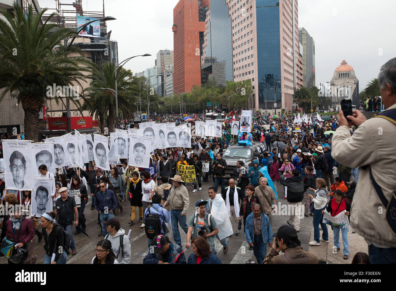 Mexico City, Mexico. 26th Sep, 2015. Thousands of people march to mark the one-year anniversary of the disappearance Stock Photo
