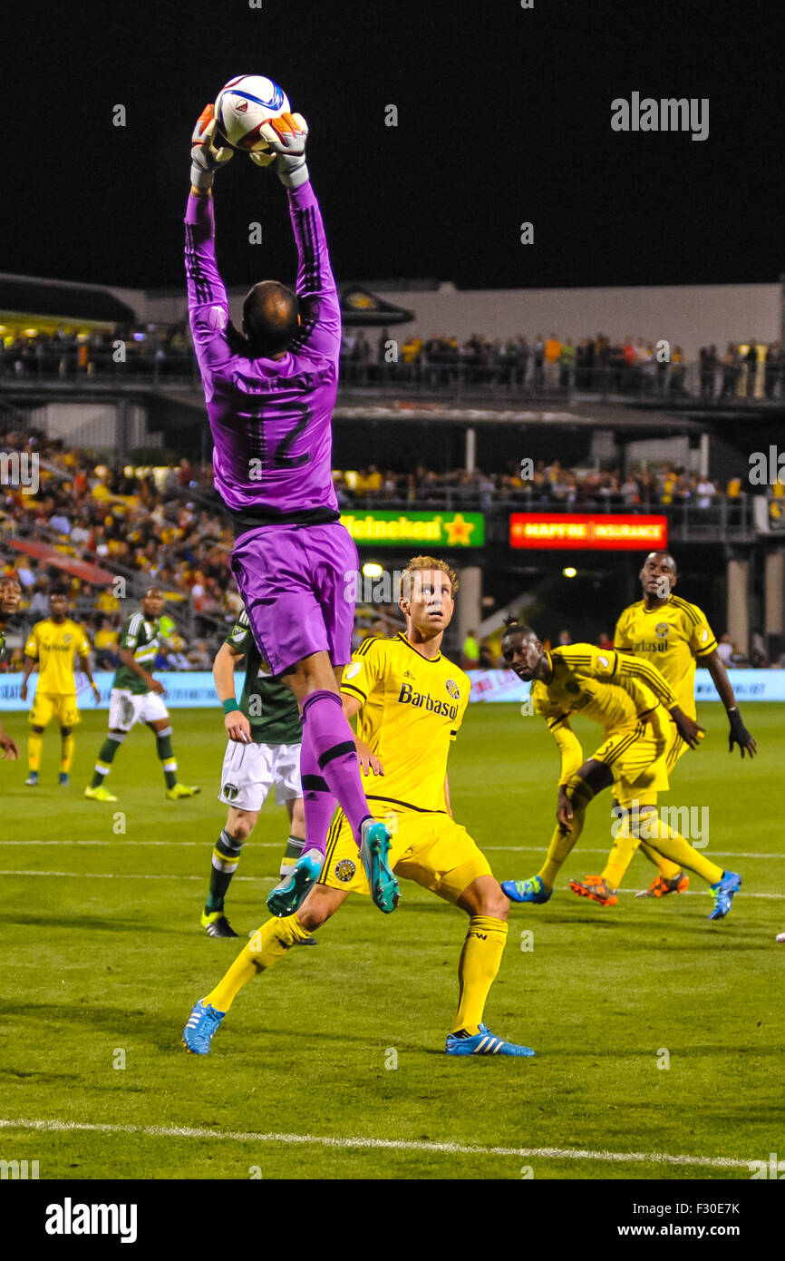 Portland Timbers FC goalkeeper Adam Kwarasey (12) jumps for a ball while Columbus Crew SC defender Tyson Wahl (2) - Stock Image