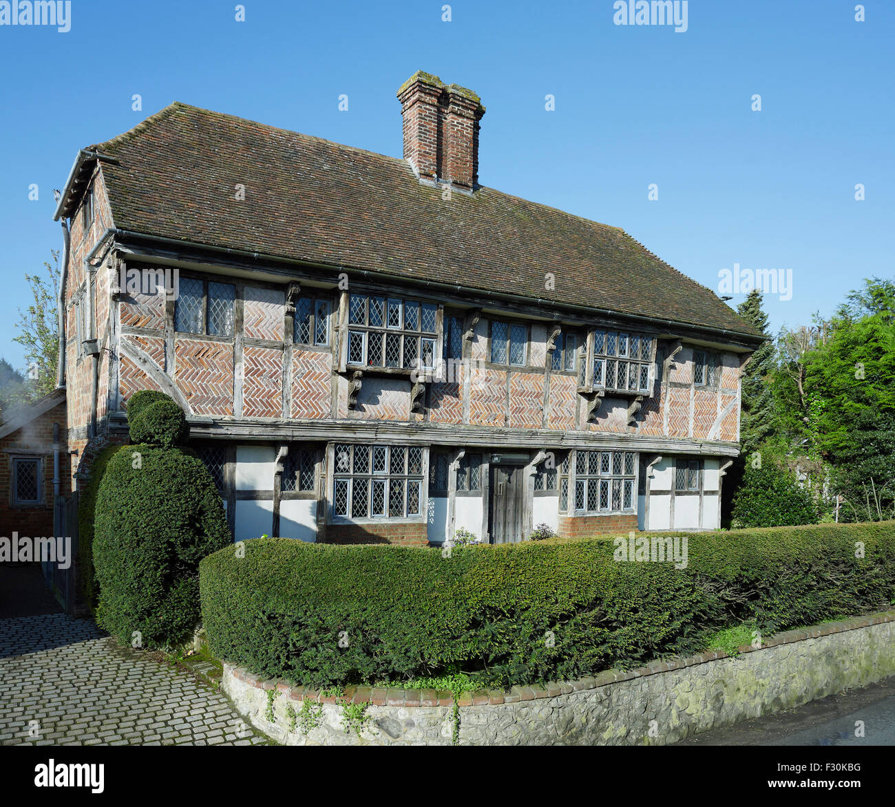 Wye, Kent. Yew Trees, timber framed house of about 1600, with herringbone brickwork Stock Photo