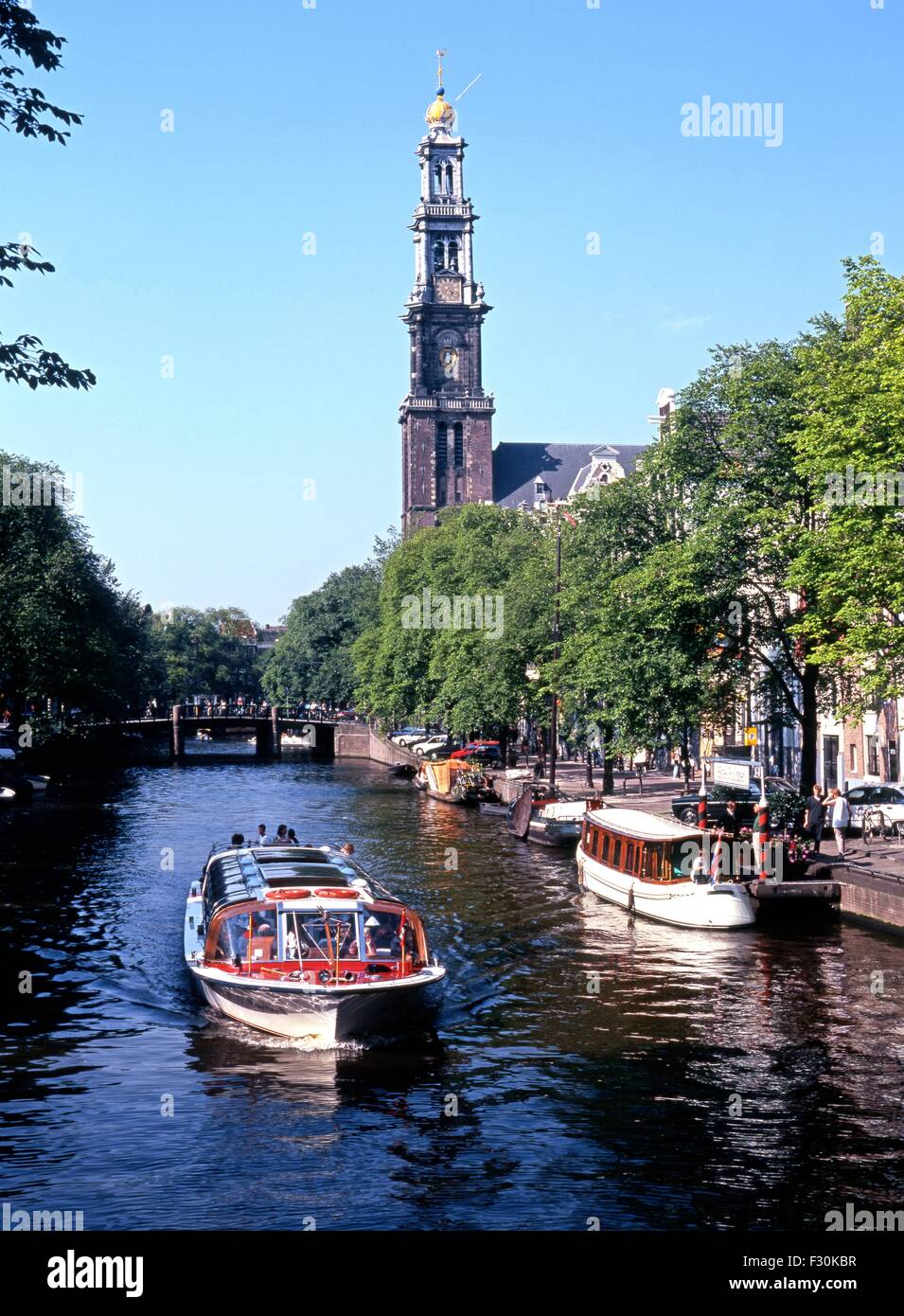 Boats on the Prinsengracht with the Westerkerk to rear, Amsterdam, Holland, Netherlands, Europe. - Stock Image
