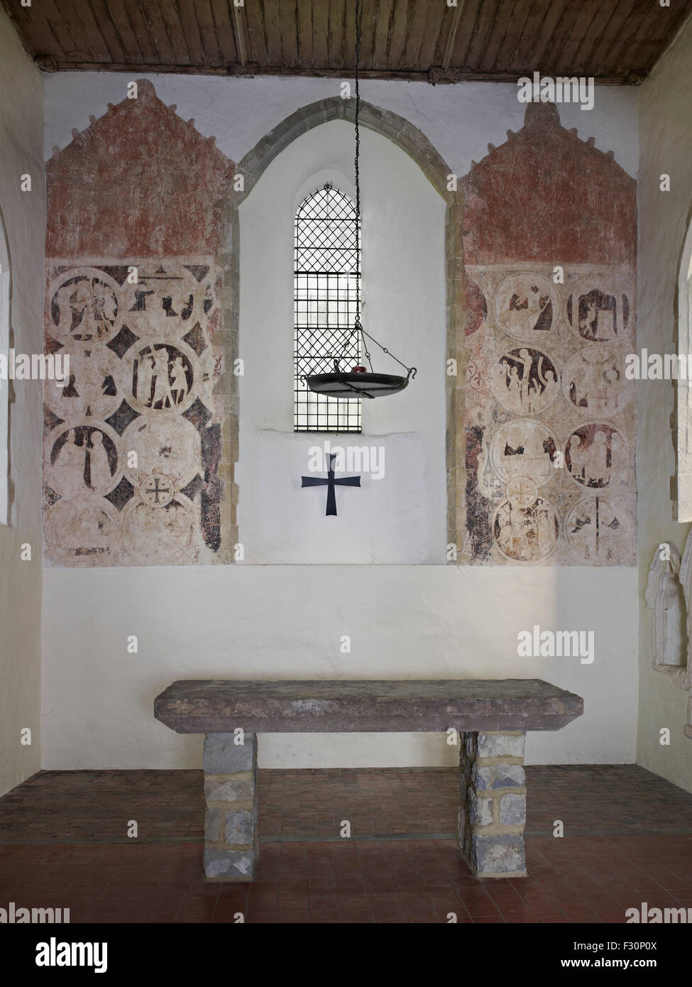 Brook, St Mary, Kent. 13th century wall paintings in the chancel - Stock Image