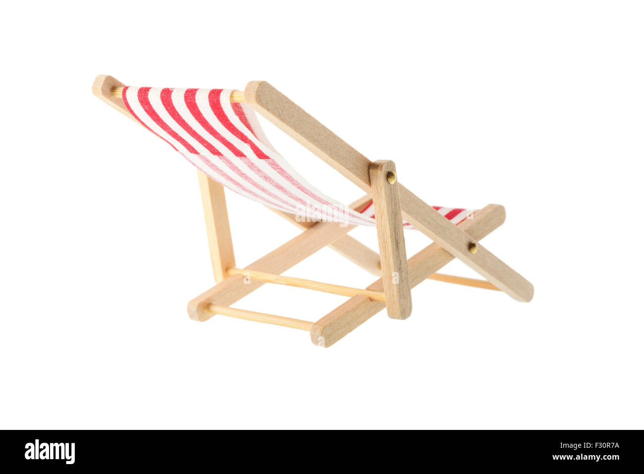 Isolated objects: wooden red striped deck chair, isolated on white background - Stock Image