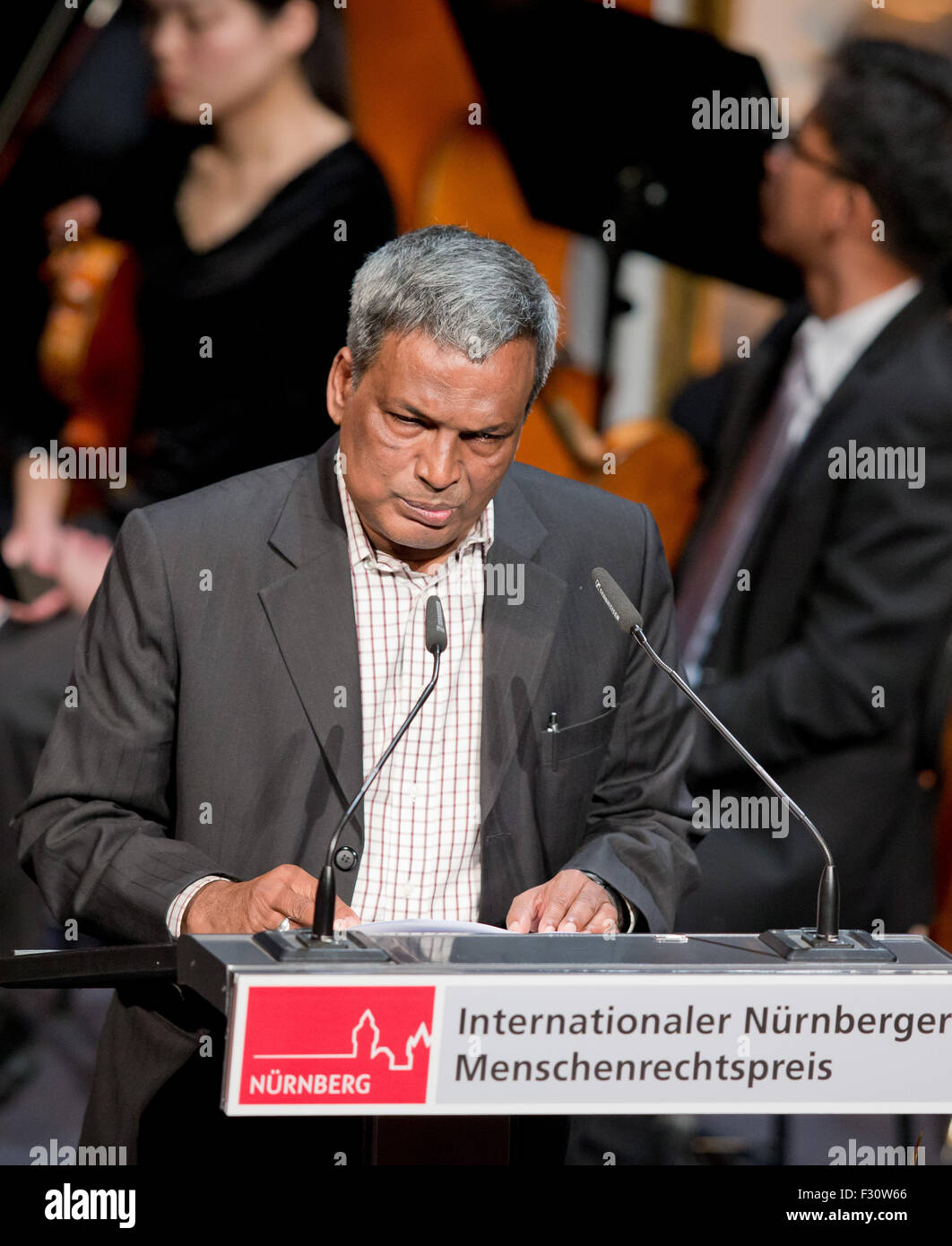 The president of the textile worker's union in Bangladesh, Amirul Haque Amin,  speaks during the International - Stock Image