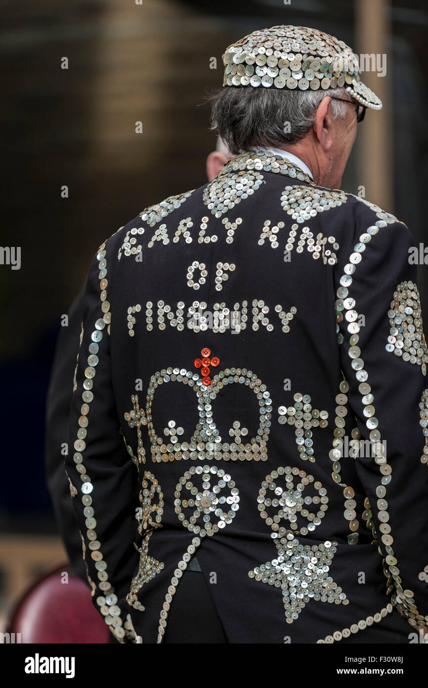 London, UK.  27 September 2015.  A man dressed in his traditional dark suit covered in hundreds of pearly buttons - Stock Image