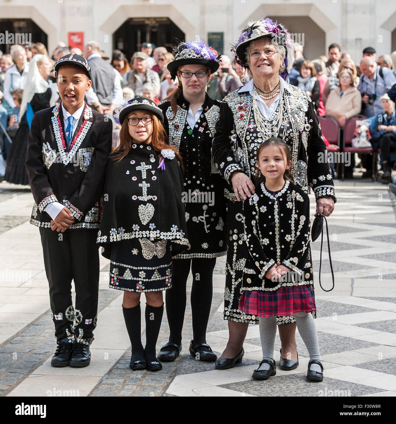 London, UK.  27 September 2015.  Pearly Kings and Queens, dressed in their traditional dark suits covered in hundreds - Stock Image