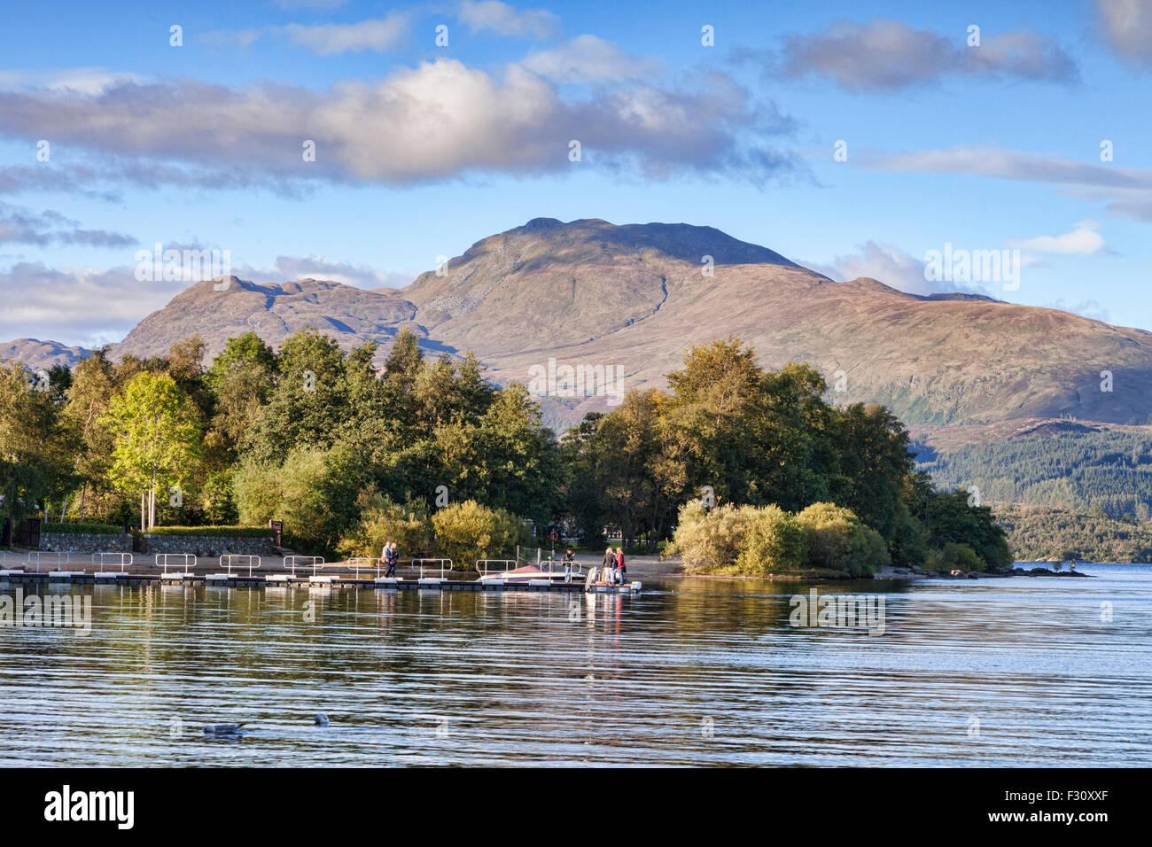 Ben Lomond and Loch Lomond at Luss, Loch Lomond and the Trossachs National Park, Stirling, Scotland, UK. - Stock Image