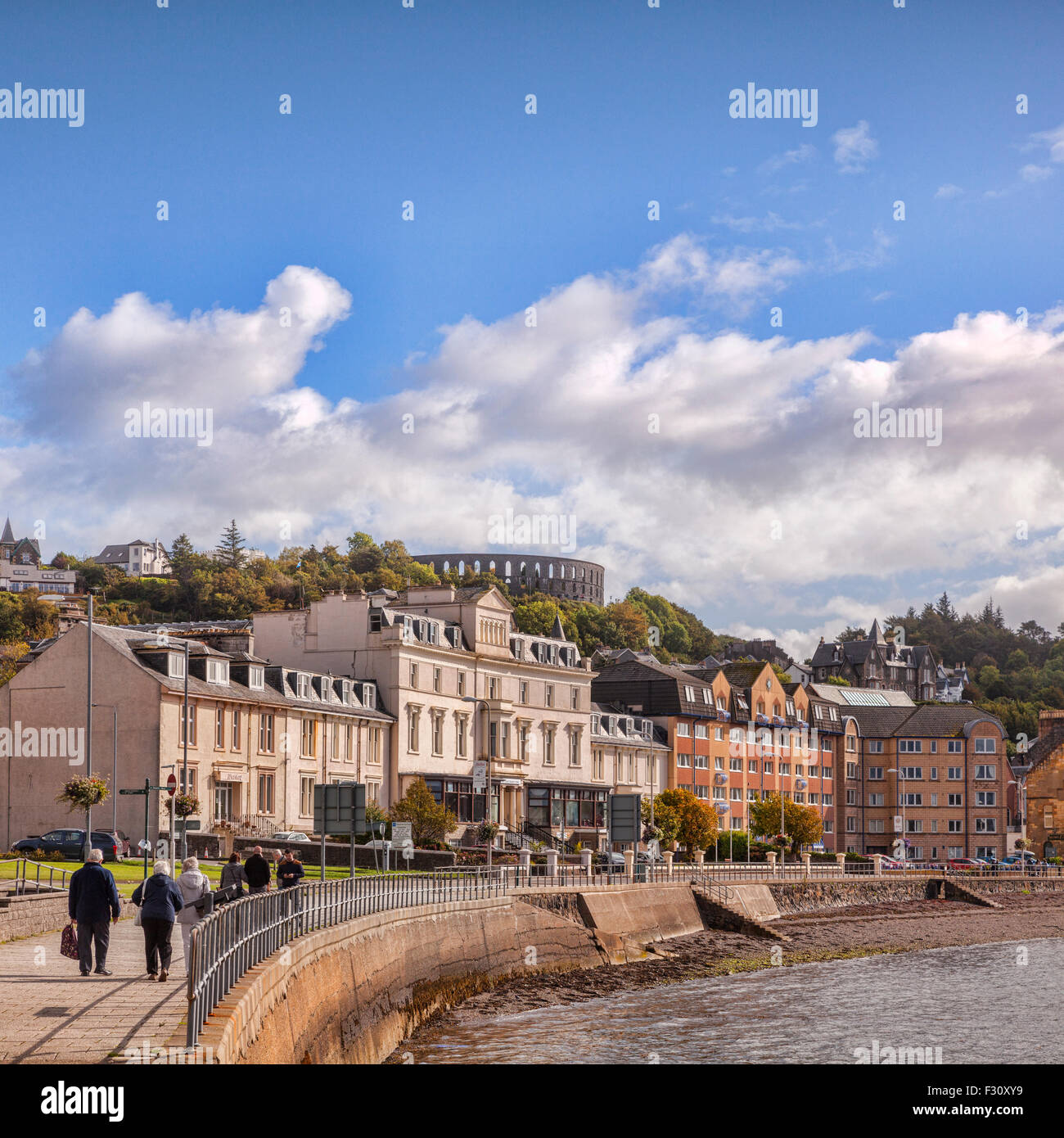 Houses and apartments on the promenade at Oban, with McCaigs Tower on the skyline, Oban, Argyll and Bute, Scotland, - Stock Image