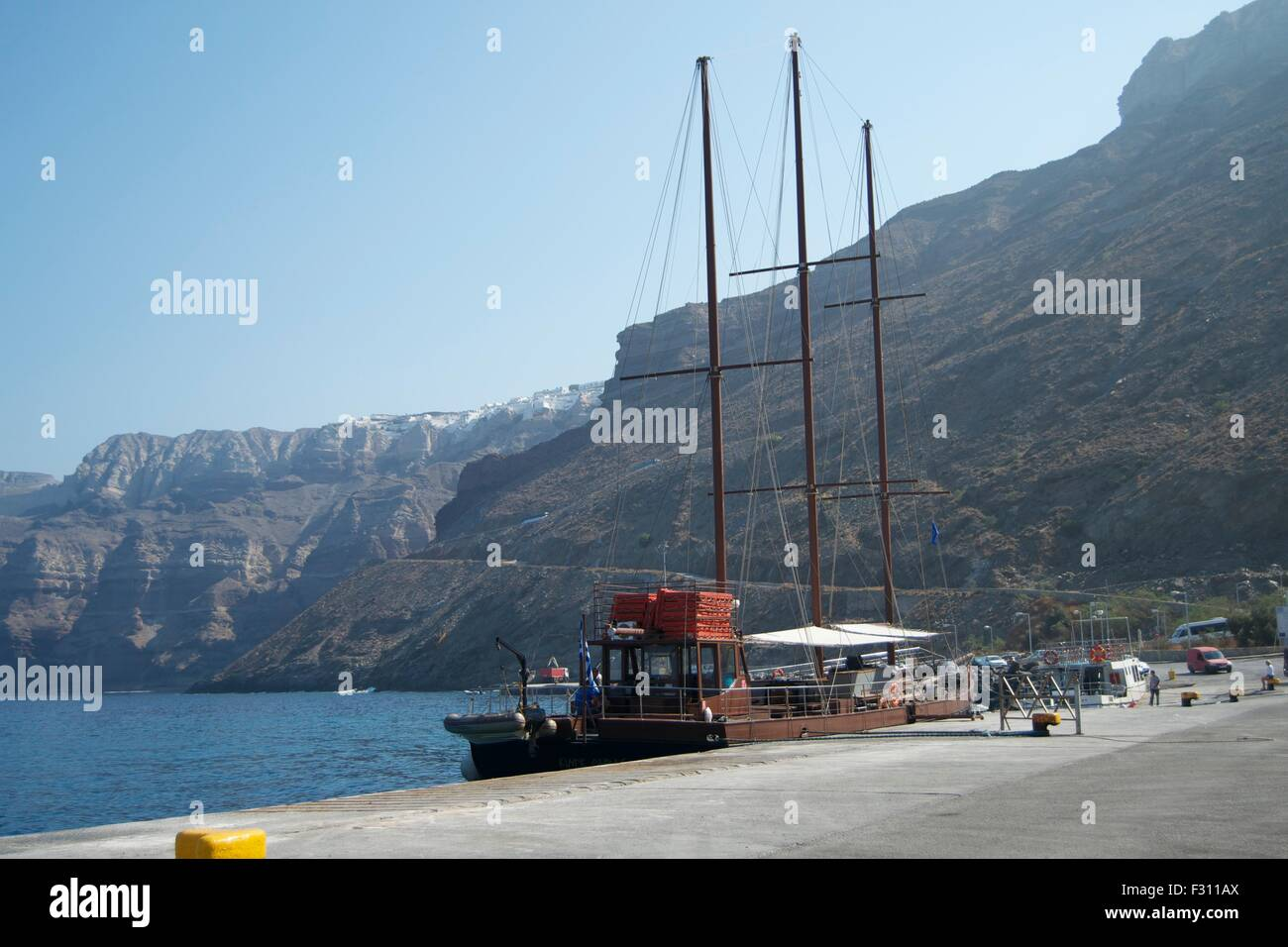 boat ship anchored harbored coast Greece Mykonos - Stock Image