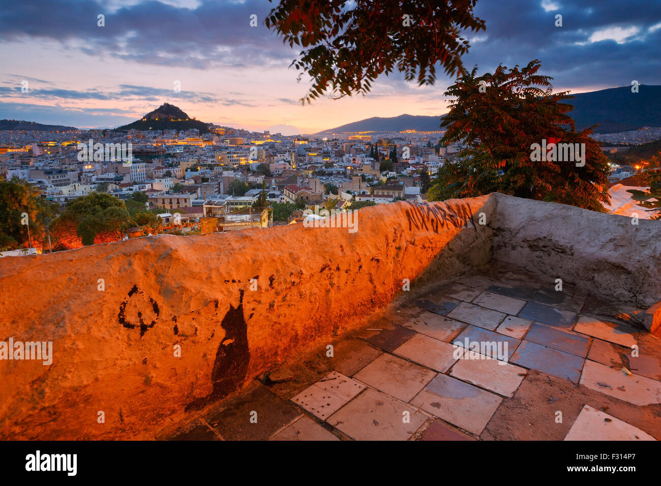 View of Athens dominated by Lycabettus hill. Image taken from Anafiotika in the old Town. - Stock Image
