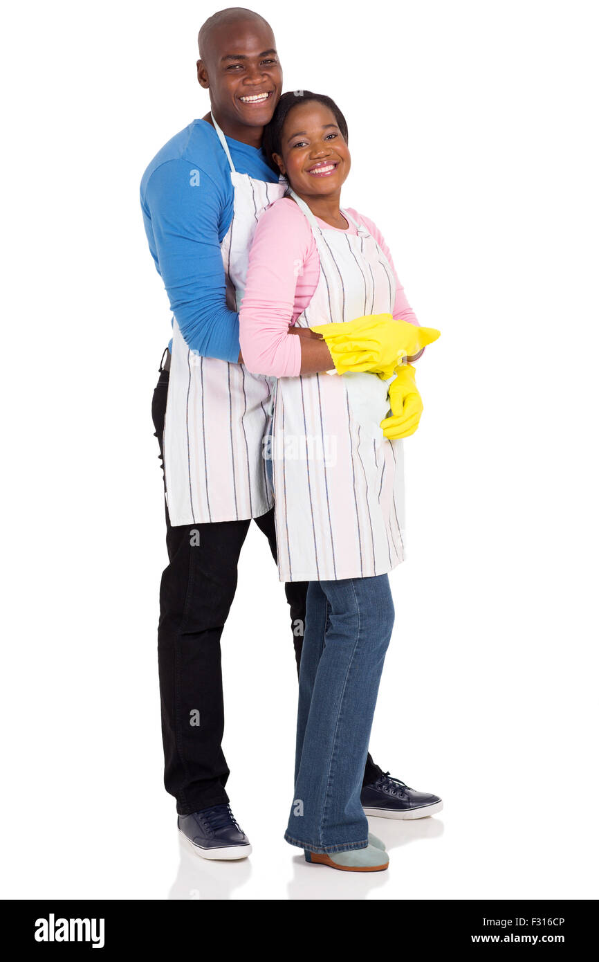 portrait of young afro American couple wearing cleaning gloves isolated on white - Stock Image