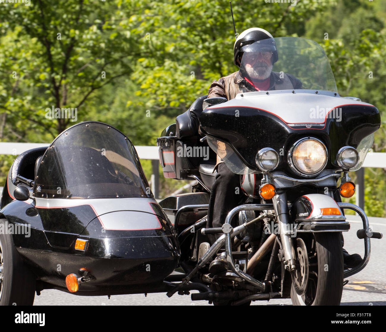 Man on a Harley Davidson Motorcycle motorbike with matching sidecar side car. - Stock Image