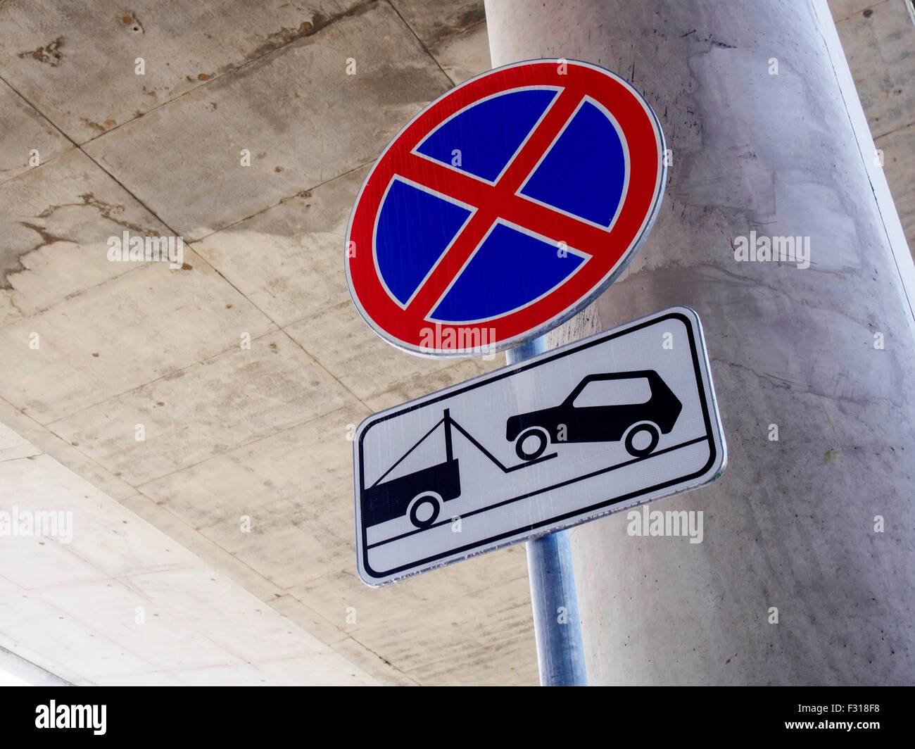 No parking sign on concrete construction in the background - Stock Image