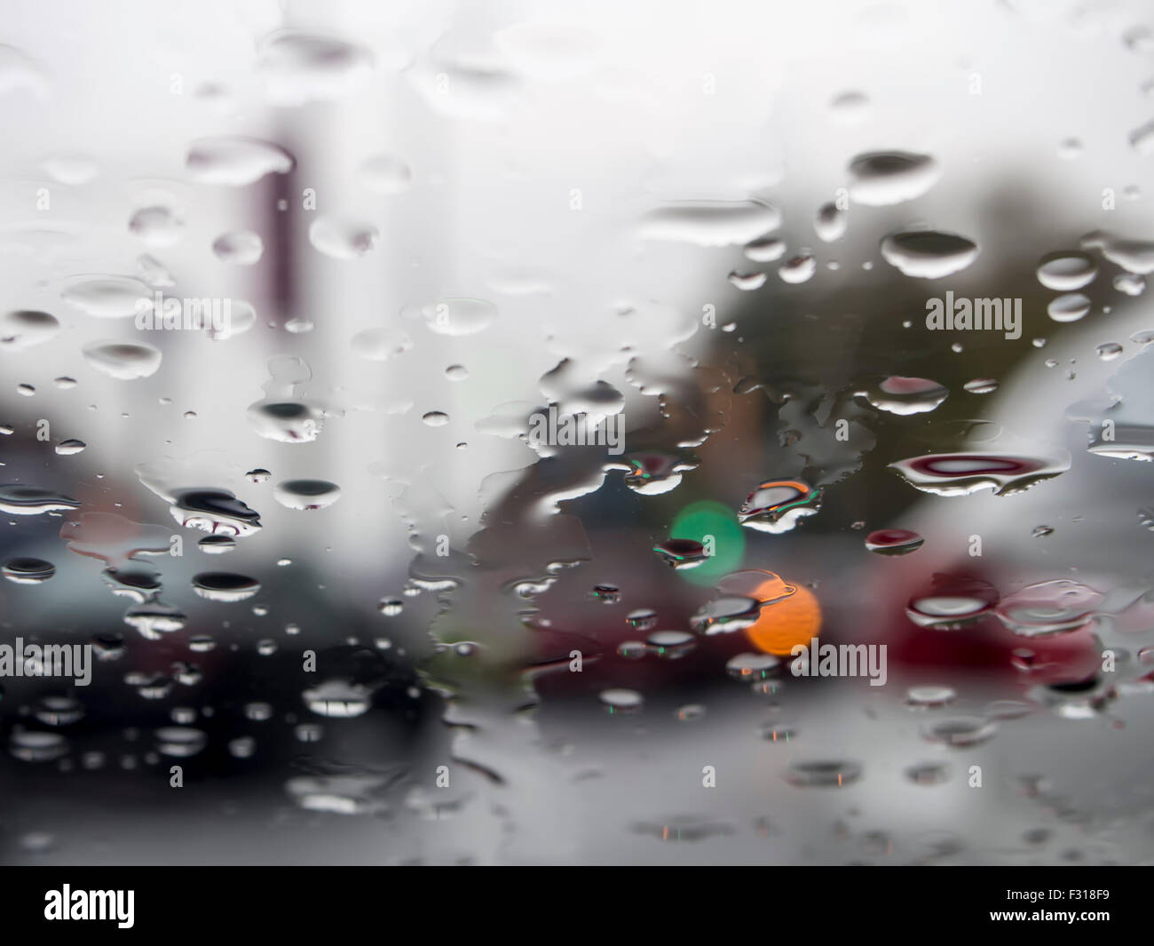 Water droplets on window of car - Stock Image
