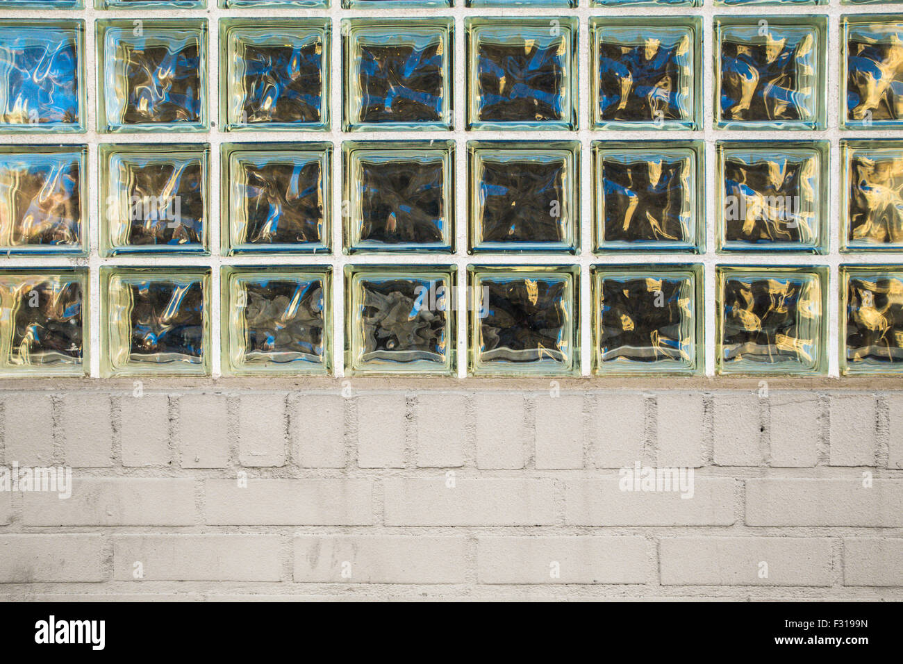 Exterior wall with privacy glass blocks and brick - Stock Image