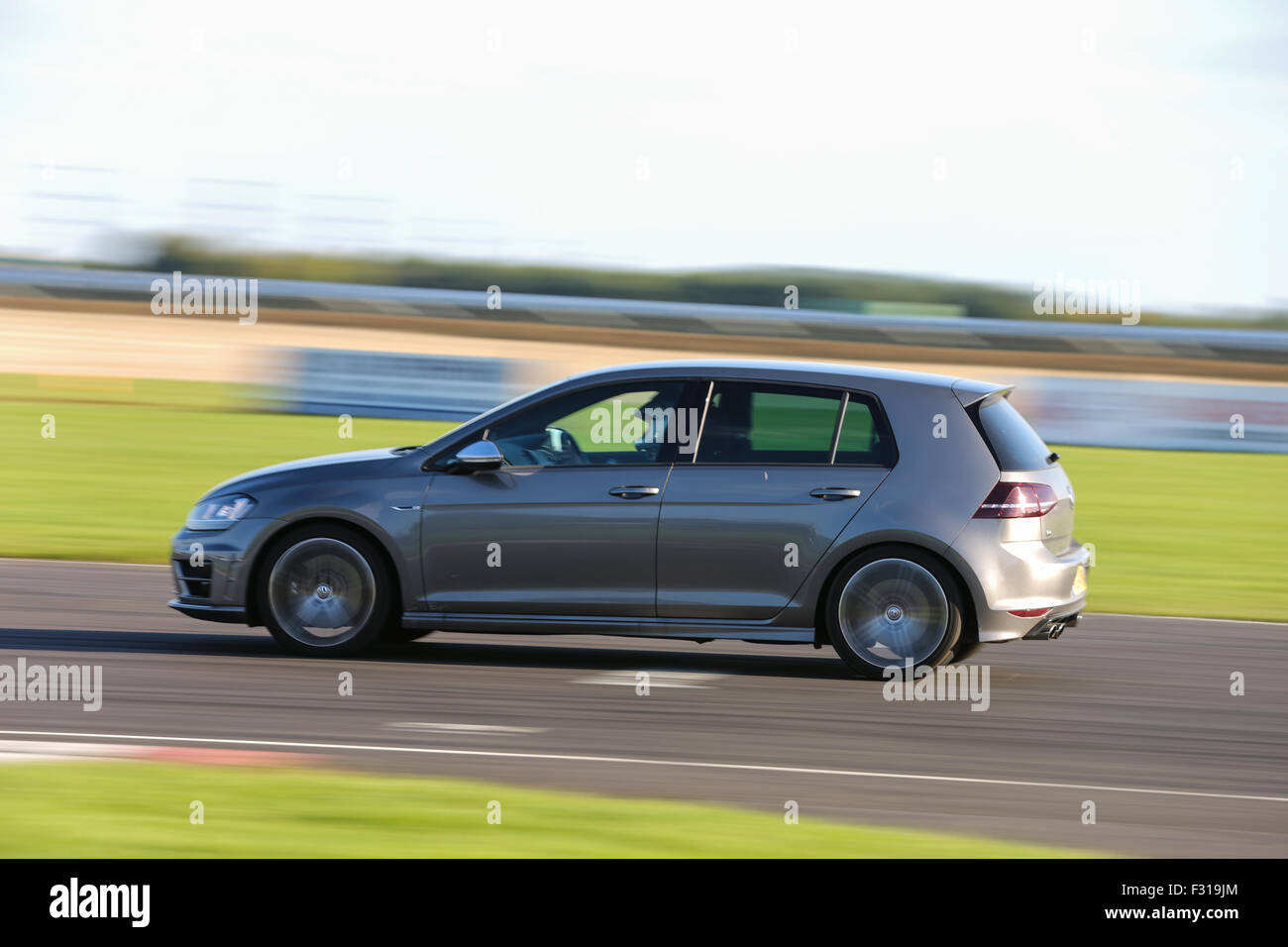 A VW Golf at Castle Combe Circuit - Stock Image