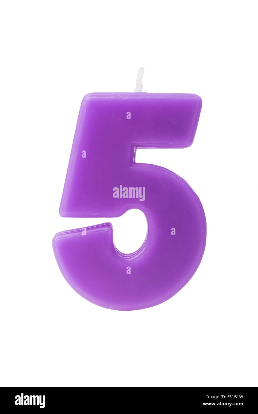 Purple birthday candle in the form of the number five on white background - Stock Image
