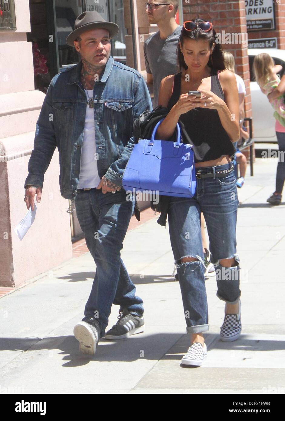 Crazy Town frontman Shifty Shellshock goes shopping in Beverly Hills with a female companion  Featuring: Shifty - Stock Image
