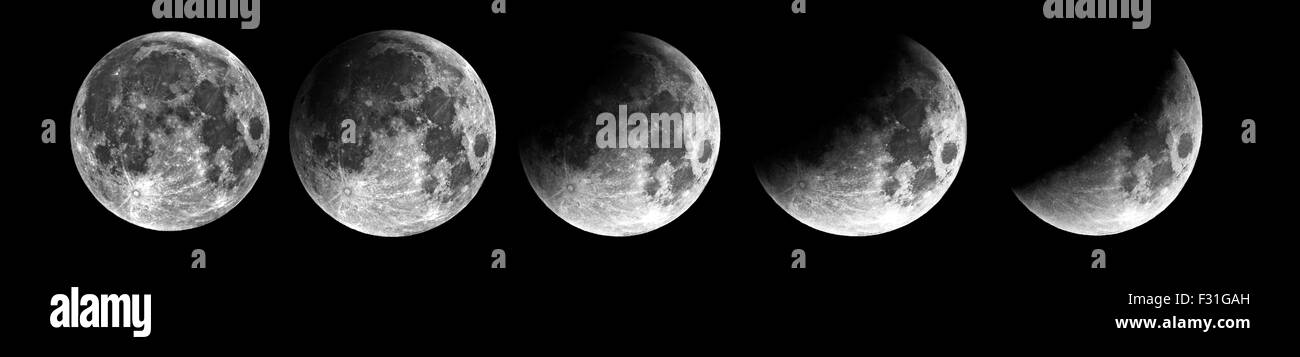Swansea, UK. 28th Sep, 2015. The earths shadow can be seen moving across the moons surface during the first phase - Stock Image
