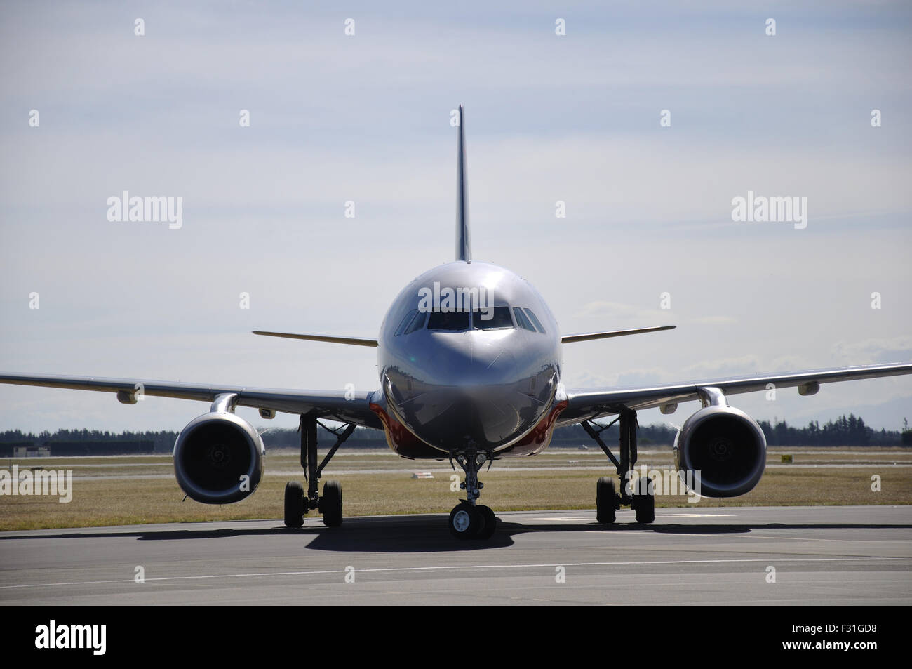 Airbus 320 waiting on the tarmac at an airport - Stock Image