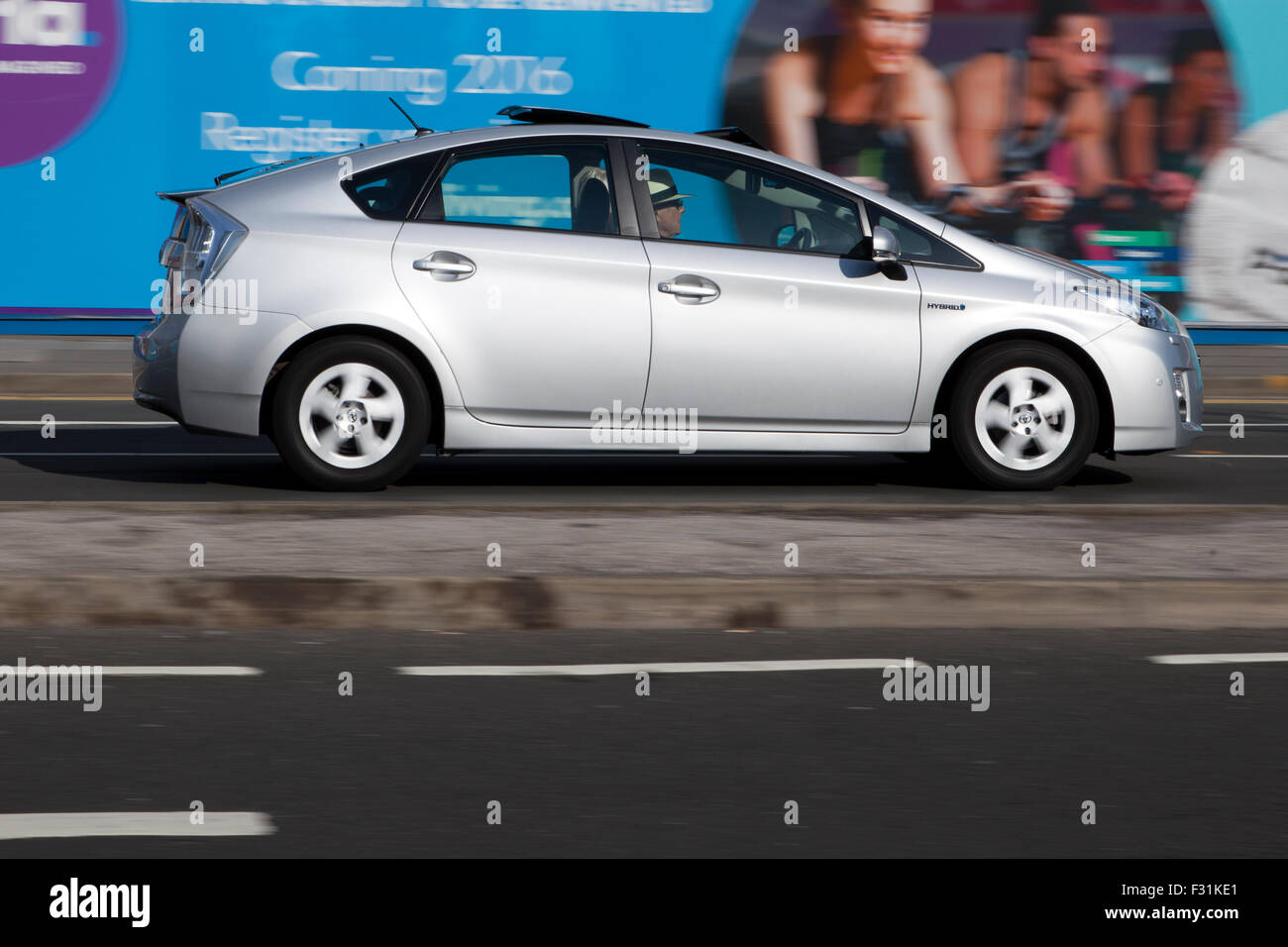A blurred moving Toyota Prius at speed motion blur on 'The Strand' at Liverpool One, Liverpool, Merseyside, - Stock Image