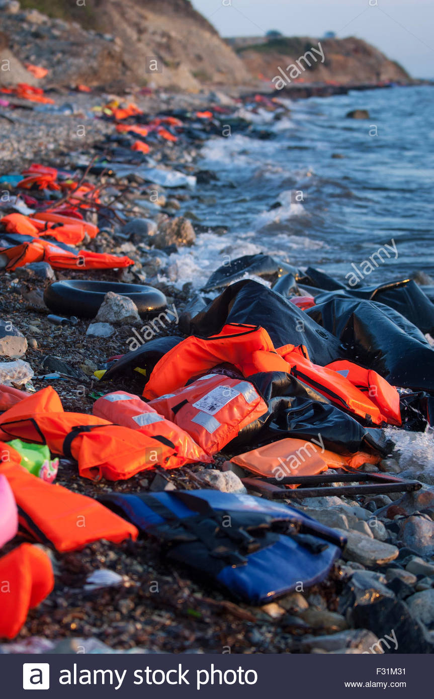 Evidence of refugees arrivals can be seen with the abandoned Life jackets cover the shore line on Lesbos, Greece. - Stock Image