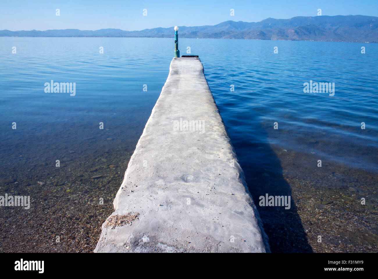 A jetty out into Geras Bay, Lesbos, Greece. - Stock Image