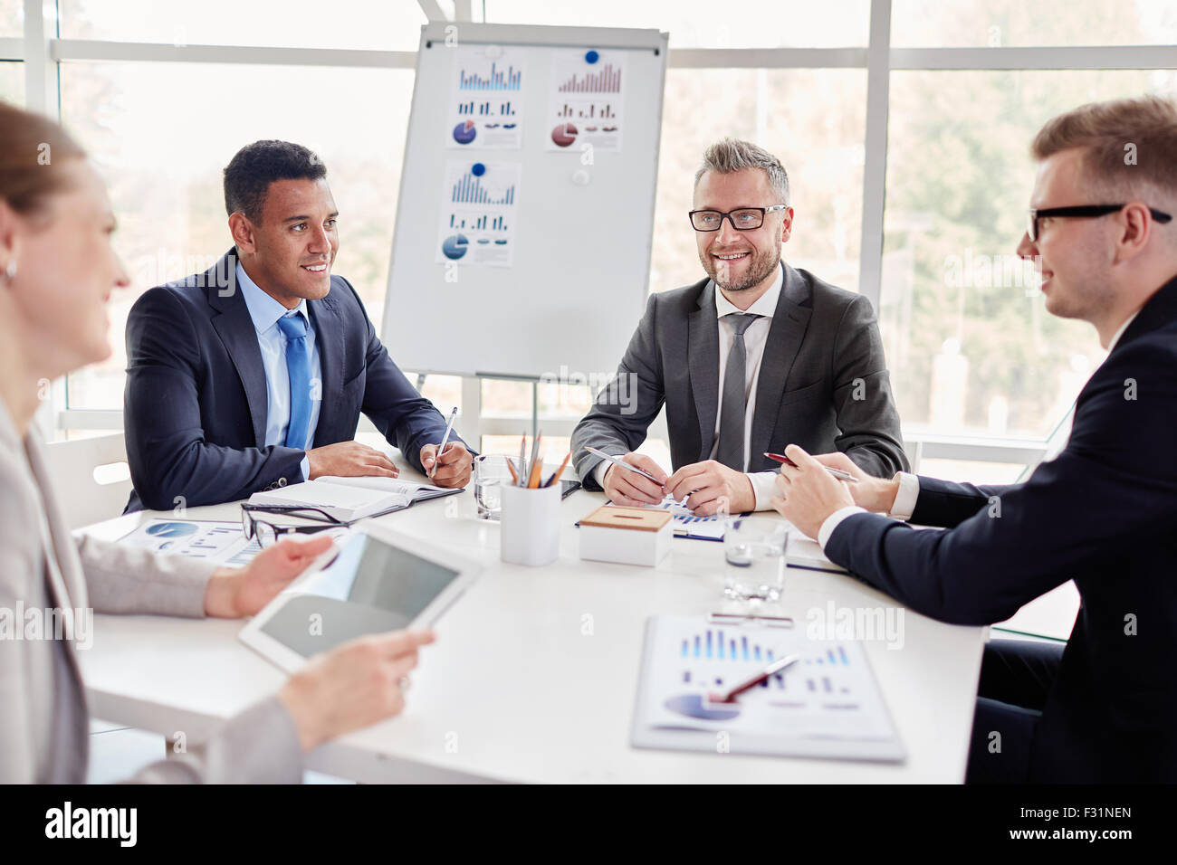 Group of confident co-workers consulting at meeting in office Stock Photo