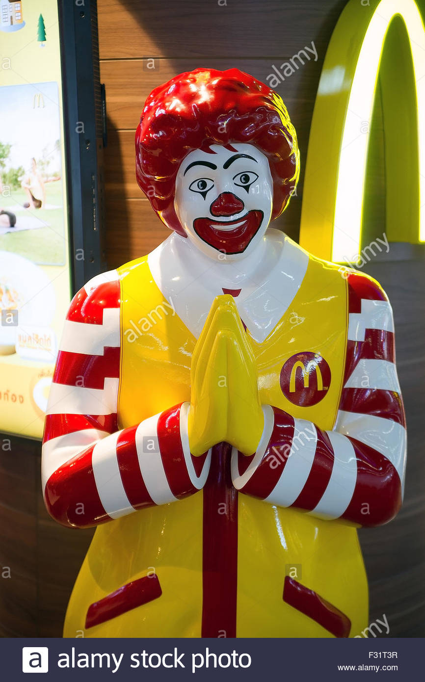 Ronald McDonald with hands joined to welcome customers in Thailand Stock Photo