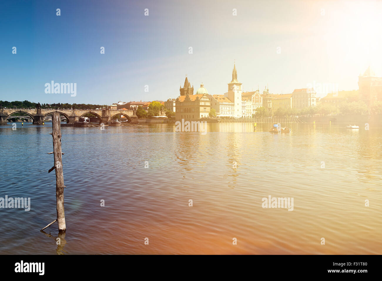 Scenic summer view of the Old Town ancient architecture and Vltava river pier in Prague, Czech Republic - Stock Image